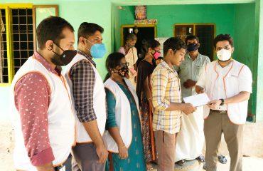 Dr Naveen handing over the vishukaineettam to Balu